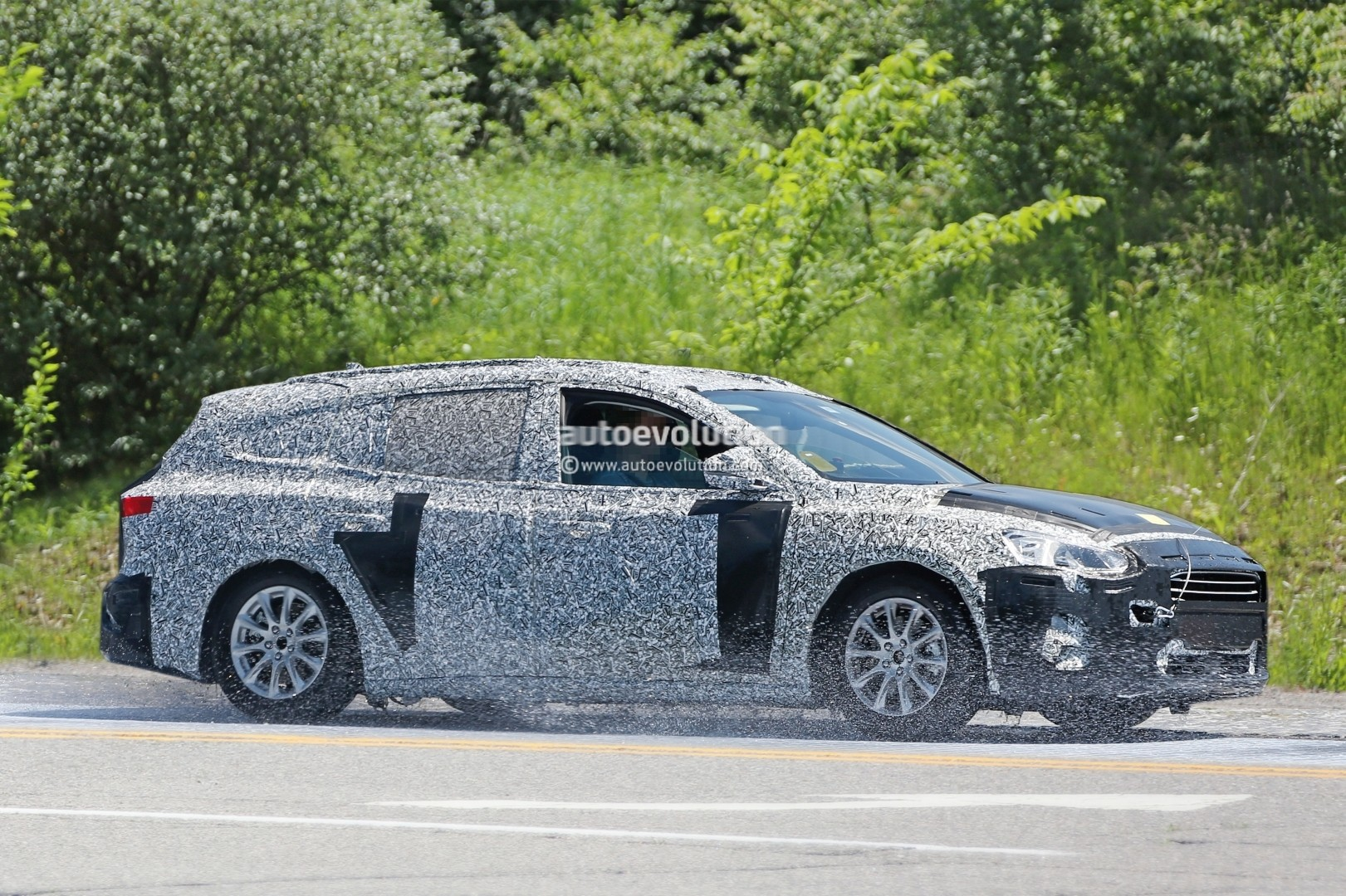 spyshots  2019 ford focus wagon prototype reveals longer rear doors