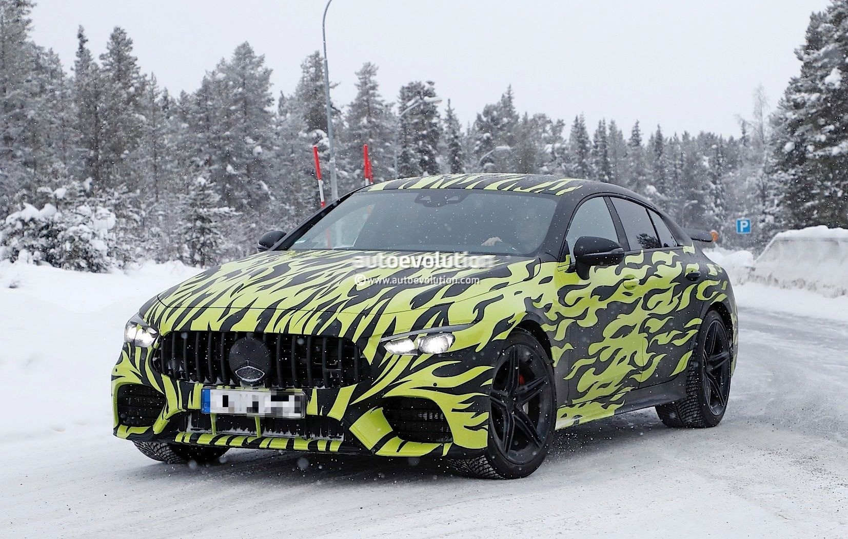 Mercedes-AMG GT Four-Door Spied Wearing Hot Rod-Style Body Wrap