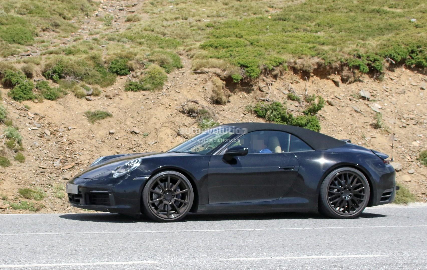 spyshots 2019 porsche 911 shows muffler design hints at new engine position autoevolution. Black Bedroom Furniture Sets. Home Design Ideas