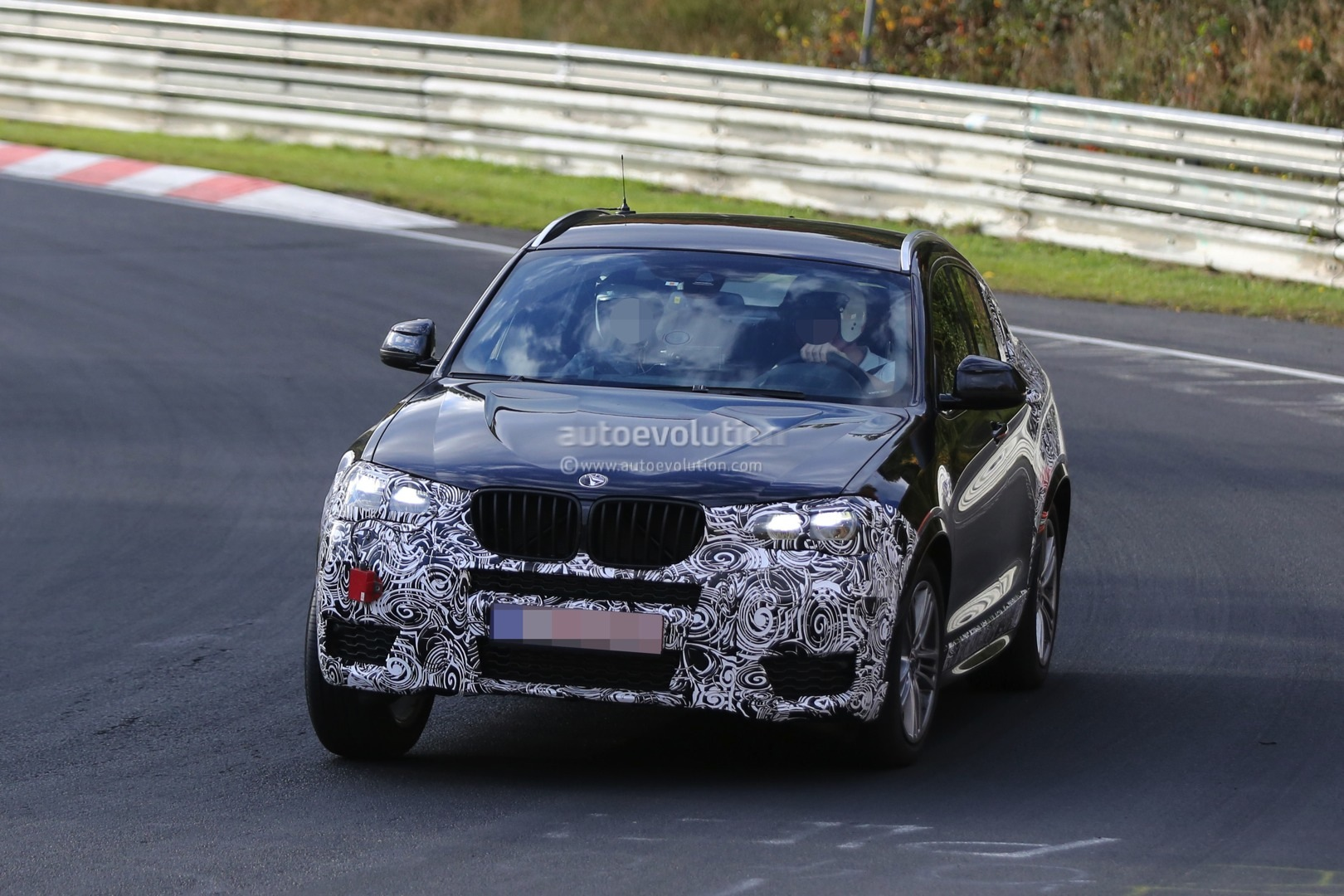 spyshots f26 bmw x4 sheds some camo at the ring autoevolution. Black Bedroom Furniture Sets. Home Design Ideas