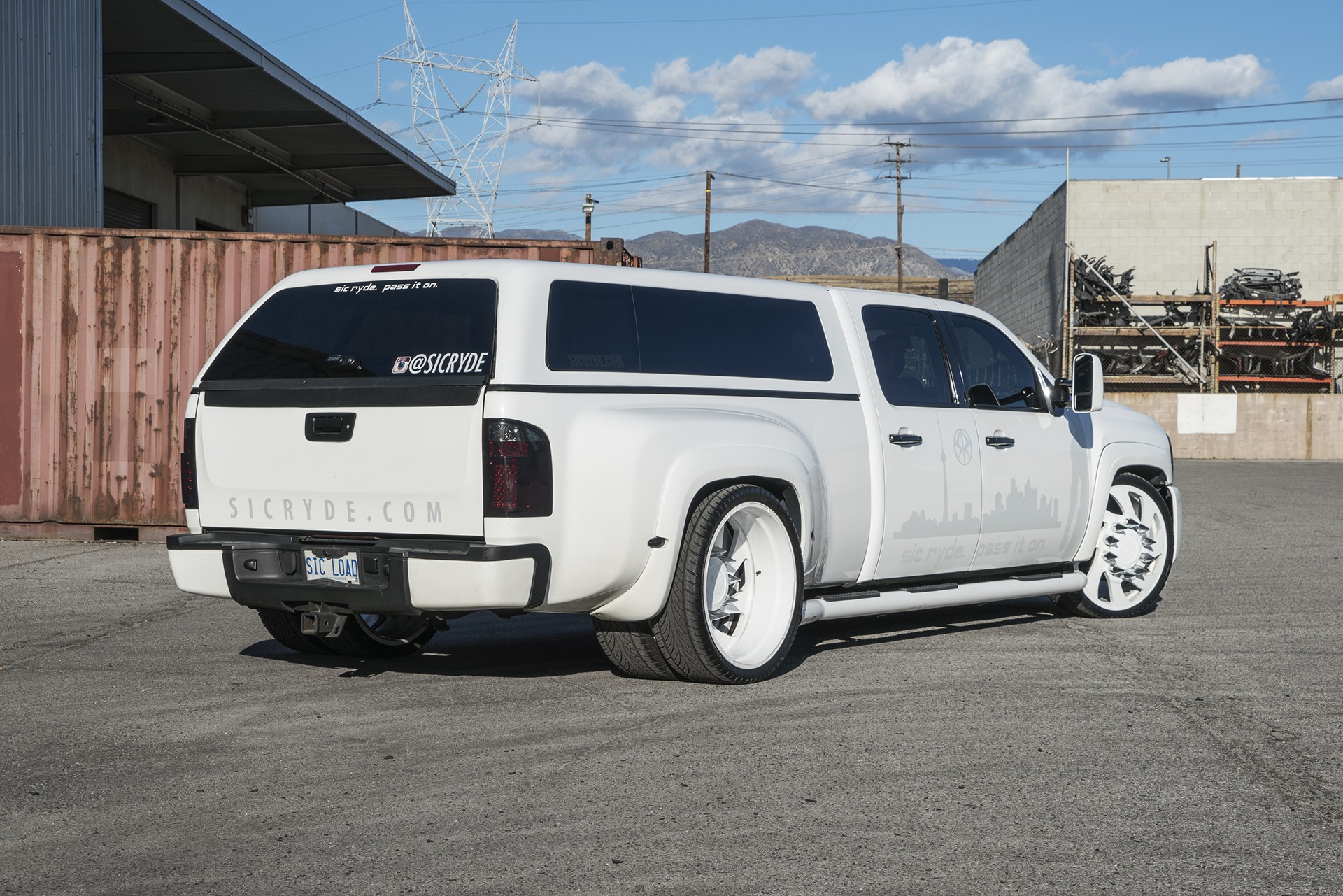 Stanced 6 wheel chevy silverado rides on forgiato dually wheels with spiked nuts photo gallery