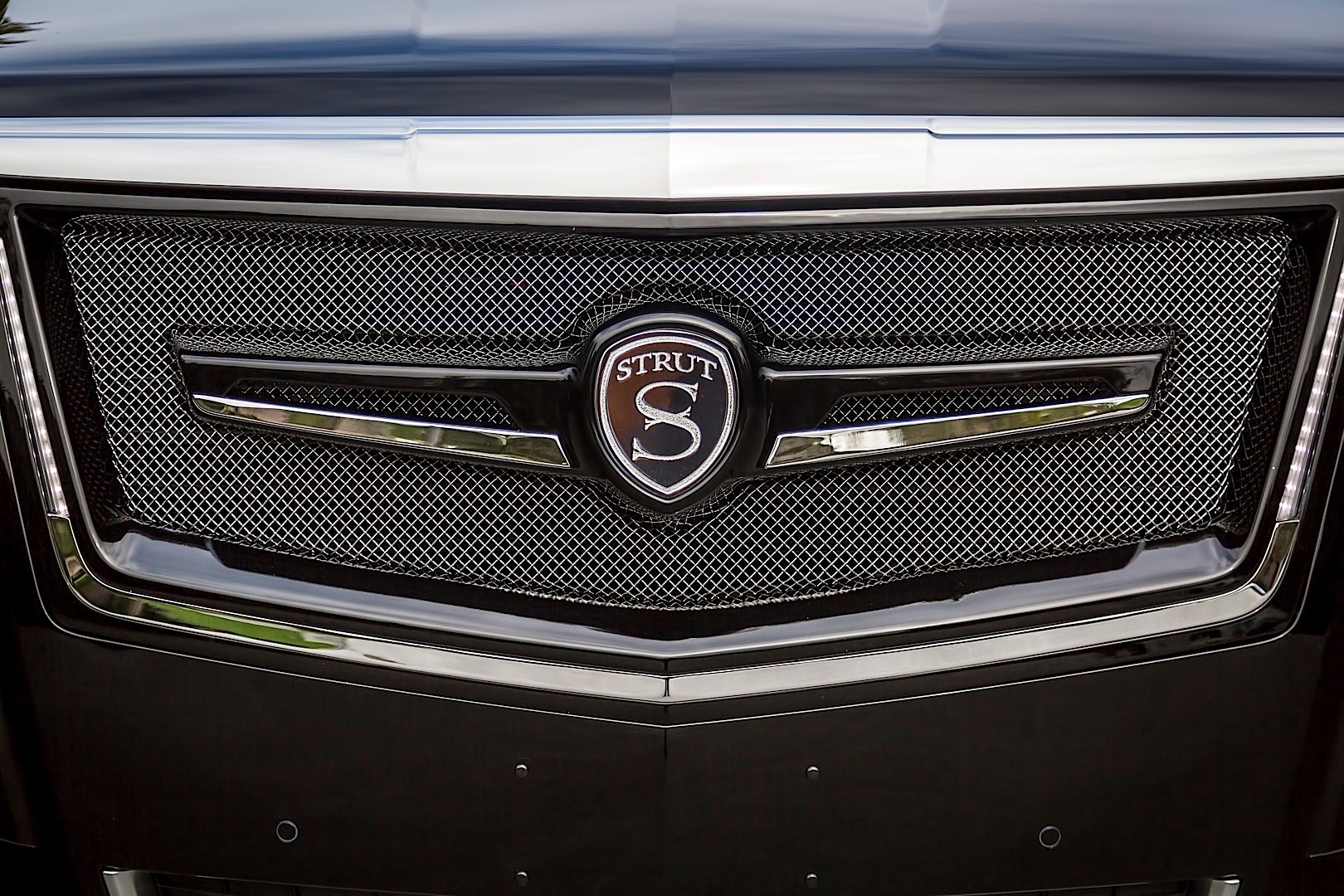 Strut Offers A Slightly More Subtle Grille For Cadillac S