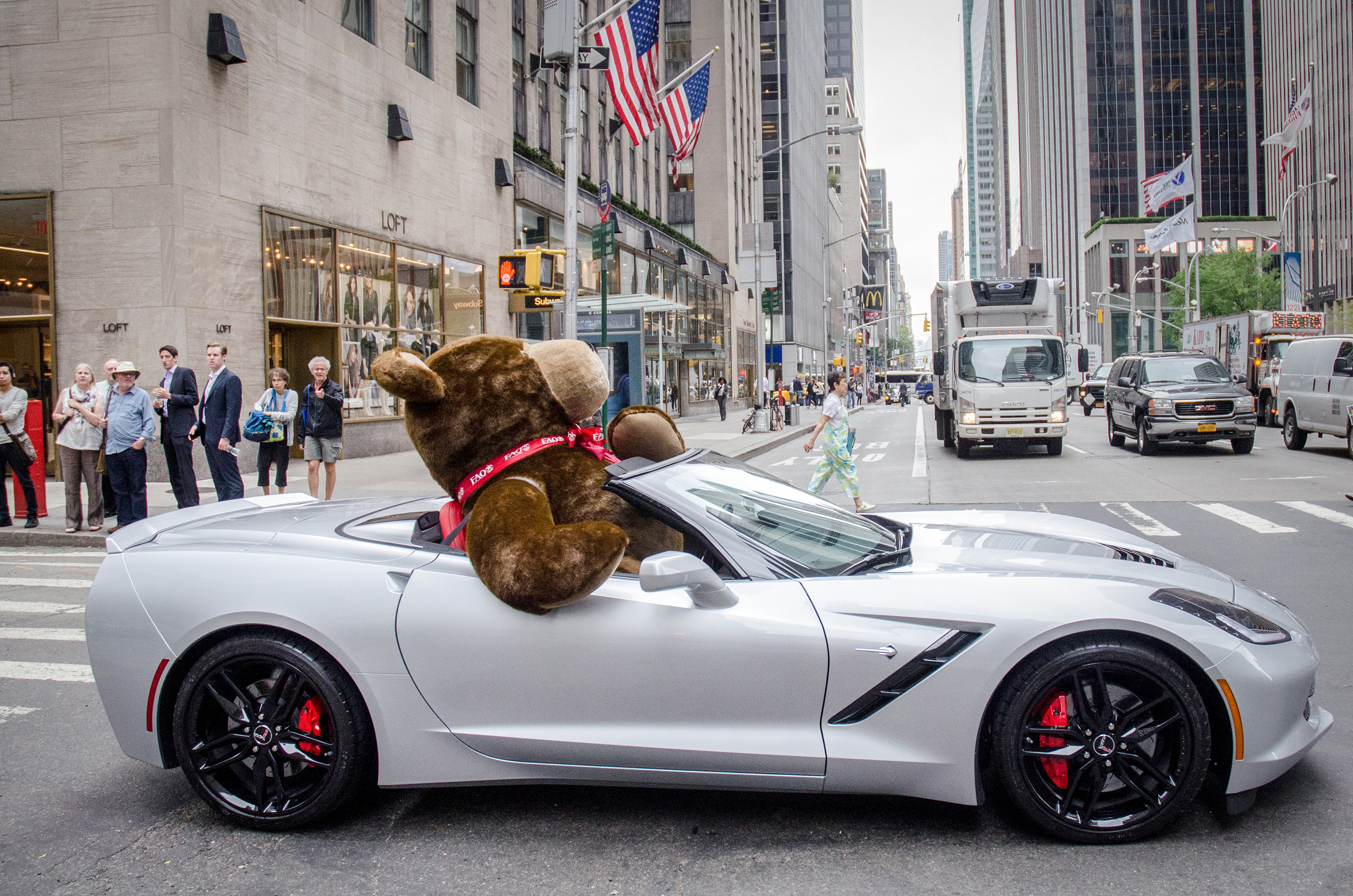 Giant teddy bear riding in a chevrolet corvette it 39 s not what you think autoevolution