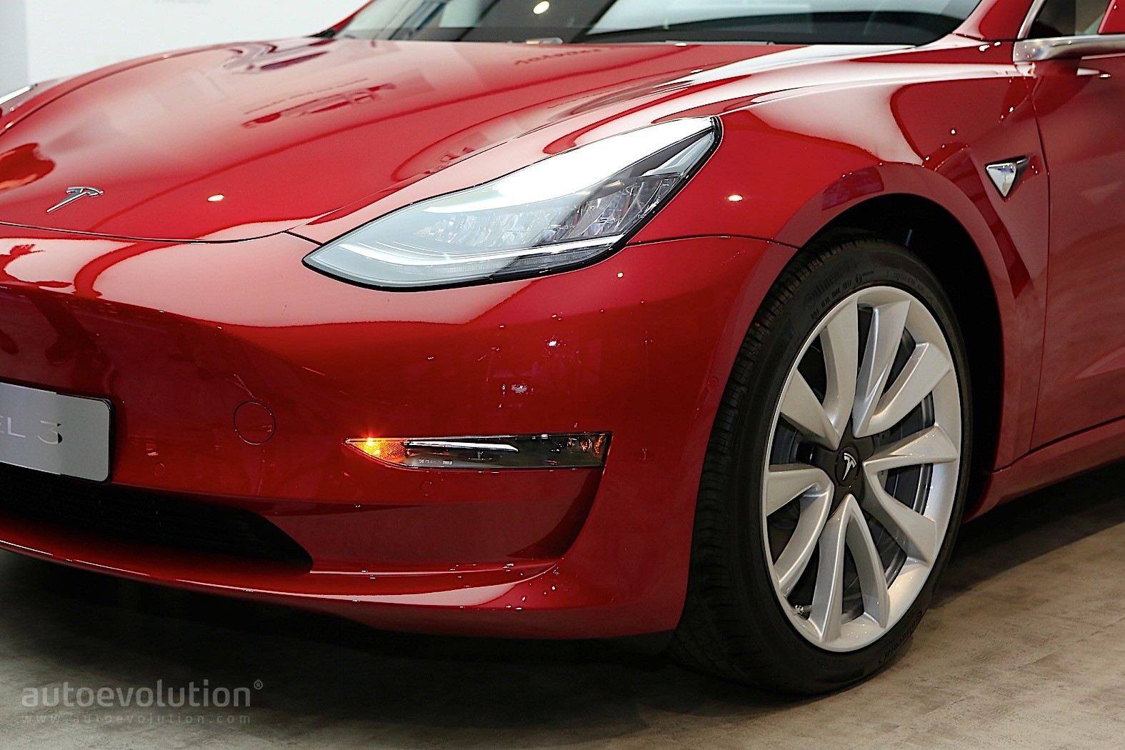 Tesla Model 3 Is The Hot Red Car Of The Moment In Paris