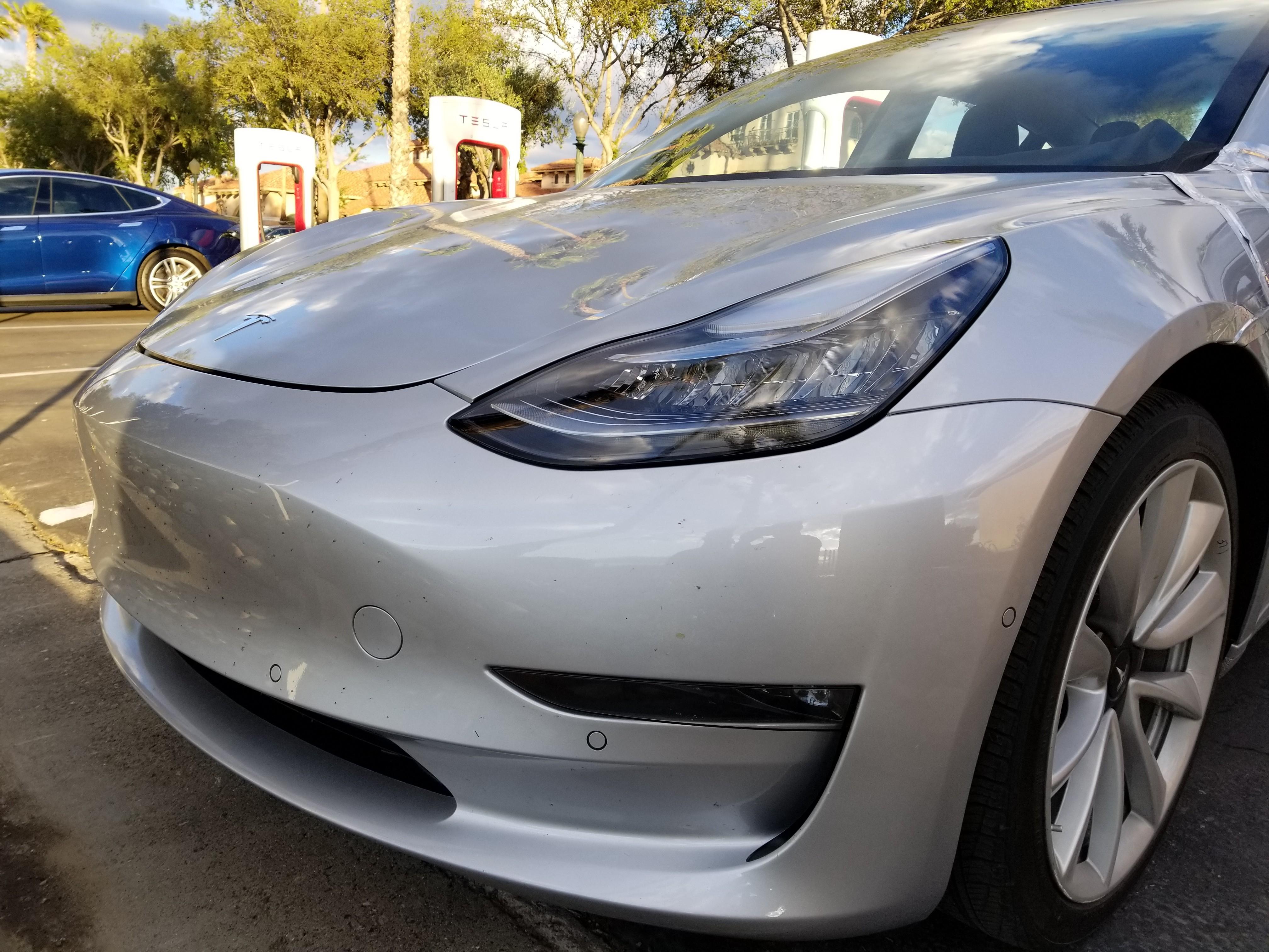 Closest Look Yet At Tesla Model 3 Exposes Panel Gaps, Manual
