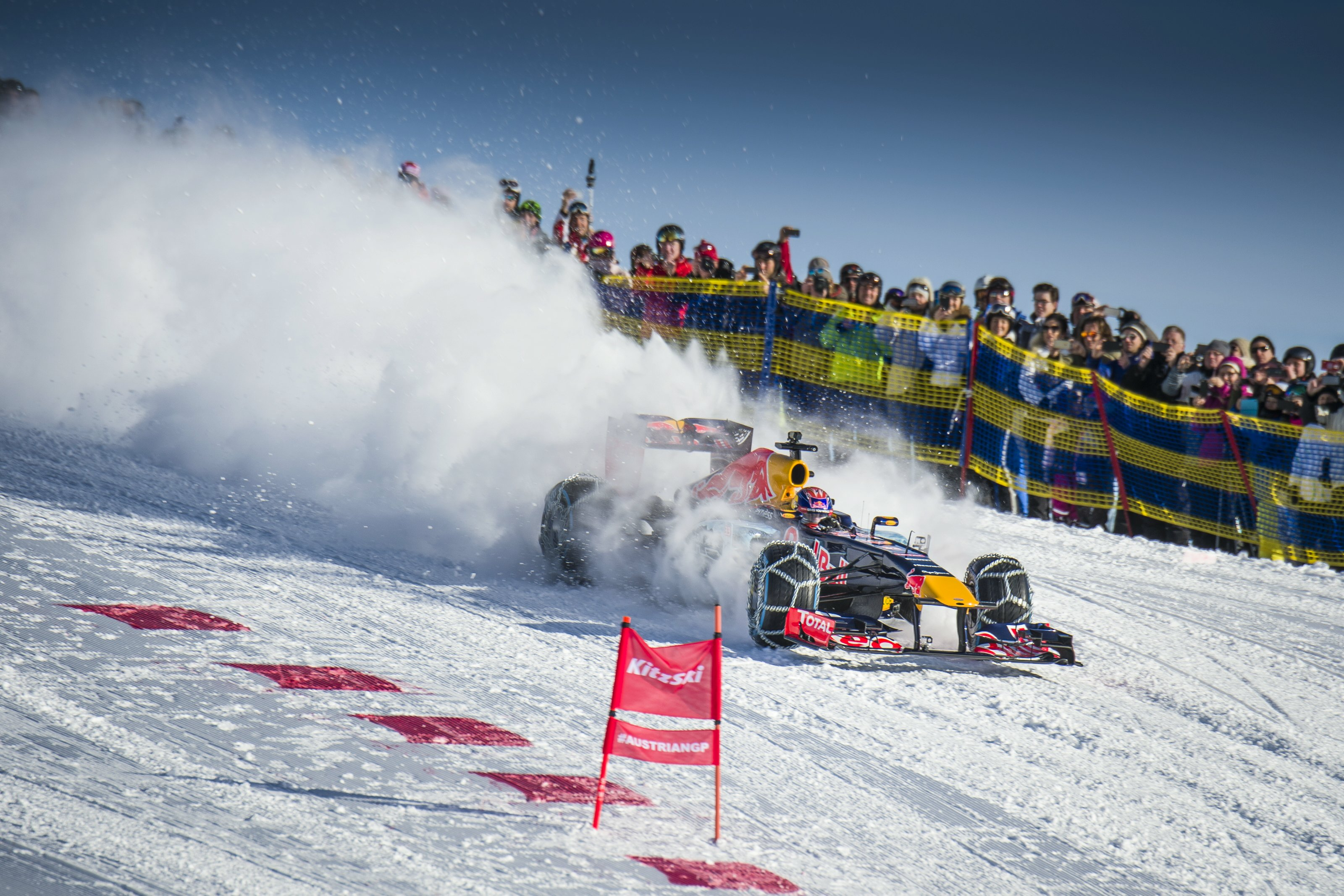 Watch A Red Bull Formula 1 Car Charge A Snowy Mountain