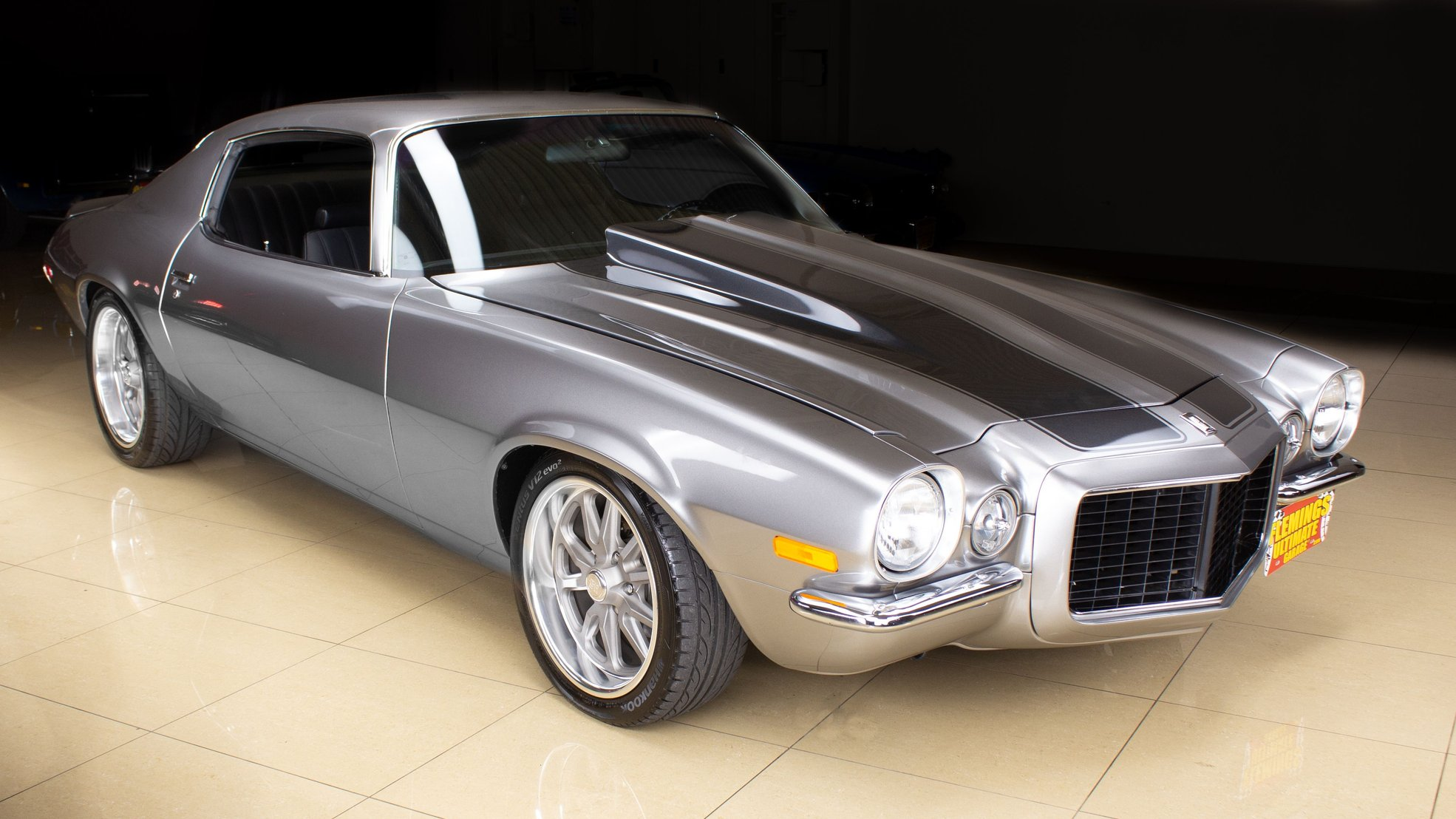 This 1970 Chevy Camaro Rs Hides Ls1 Engine Under Slick Cowl Induction Hood Autoevolution