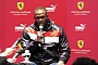 Usain Bolt talks to the media in Maranello