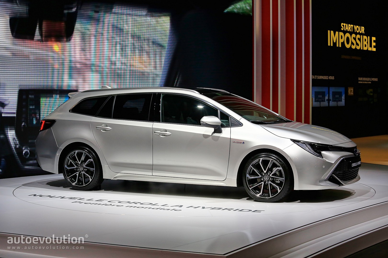 toyota corolla hybrid wagon has giant trunk and even bigger tablet in paris autoevolution. Black Bedroom Furniture Sets. Home Design Ideas