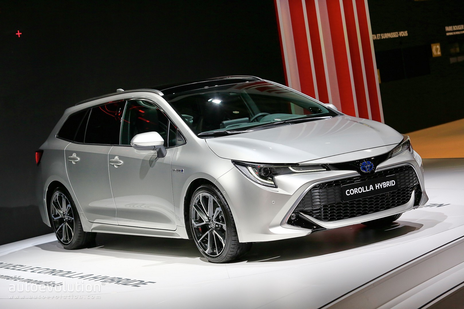Toyota Corolla Hybrid Wagon Has Giant Trunk And Even Bigger Tablet In Paris