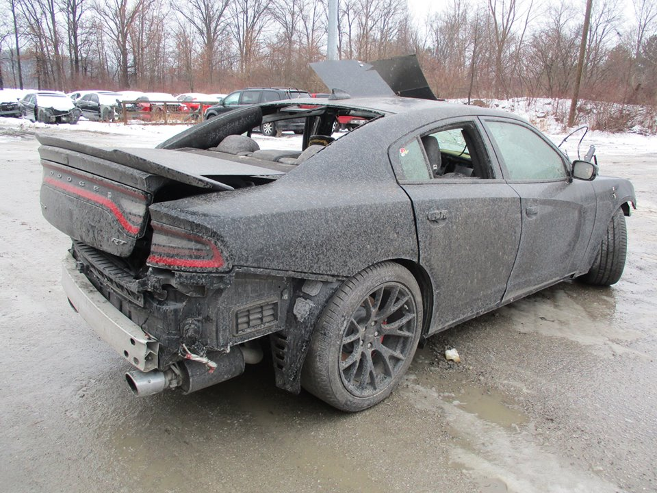 wrecked dodge charger hellcat shows up for sale is full of bullet. Black Bedroom Furniture Sets. Home Design Ideas