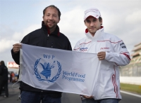 Timo Glock with DJ BoBo (a United Nations World Food Programme National Ambassador Against Hunger)