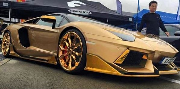 Gold-Themed Lamborghini Aventador Roadster Has All the Once ... on gold ford mustang convertible, gold bmw convertible, gold lamborghini veneno roadster, gold corvette convertible, gold audi convertible, gold ferrari convertible,