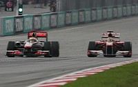 Alonso trying to pass Hamilton at Sepang