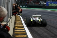 Jenson Button crosses the finish line of the Brazilian GP