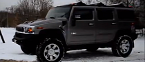 Hummer Hilariously Fails to Climb Small Concrete Block [Video]