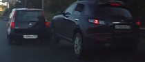 Infiniti SUV Almost Mounts Small Car, Runs From Accident Scene [Video]