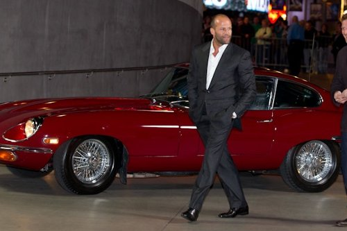 jaguar e type brings jason statham to the mechanic
