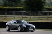An XK-R gunning towards a chicane.