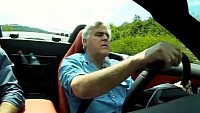 Jay Leno tastes a piece of the open-top Gullwing
