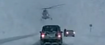 Just Another Day in Russia: Helicopter Lands on Highway [Video]