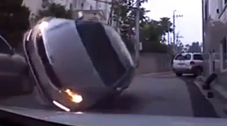 Kia Flips Over After Crashing into Parked SUV [Video]
