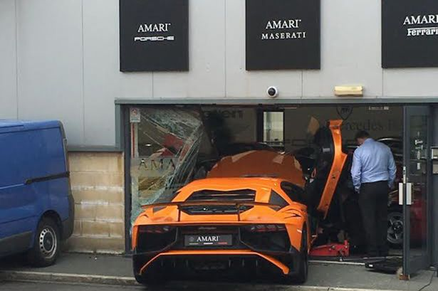 Lamborghini Crashes Into Luxury Showroom Takes Two Ferraris Down