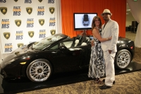 The Lp 560-4 Spyder and the couple that plaed the winning bid