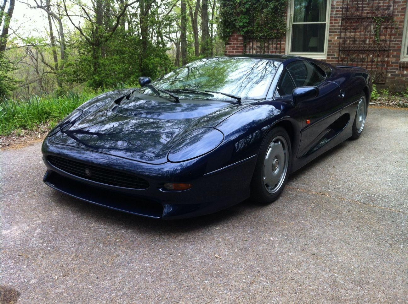 last jaguar xj220 ever built sold on ebay for $299k - autoevolution