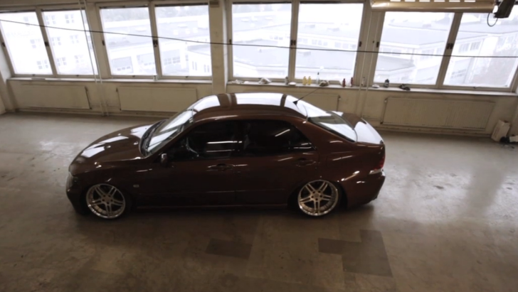 low lexus is sitting high in tall building garage. Black Bedroom Furniture Sets. Home Design Ideas