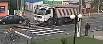 Lucky Bicyclist Avoids Being Run Over by Truck [Video]