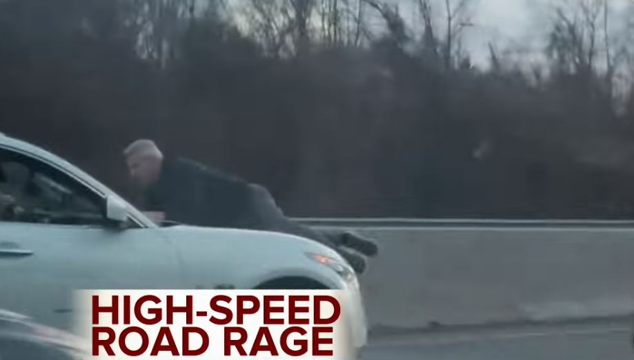 Man Clings To Hood Of SUV In High-Speed Road-Rage Incident