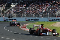 Jenson Button goes after Felipe Massa