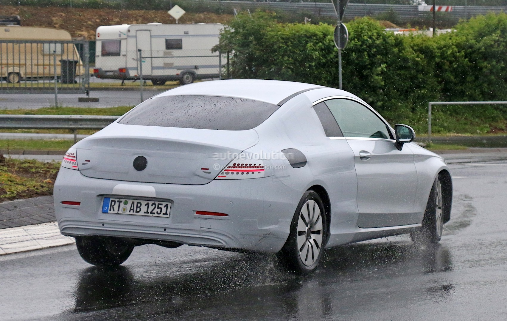 Mercedes benz c class coupe spied half naked looks like a for Mercedes benz c350 coupe