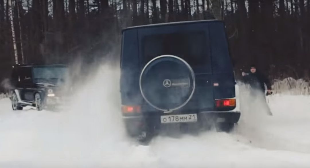 Mercedes g class russian snow battle g63 amg vs for Mercedes benz tire chains