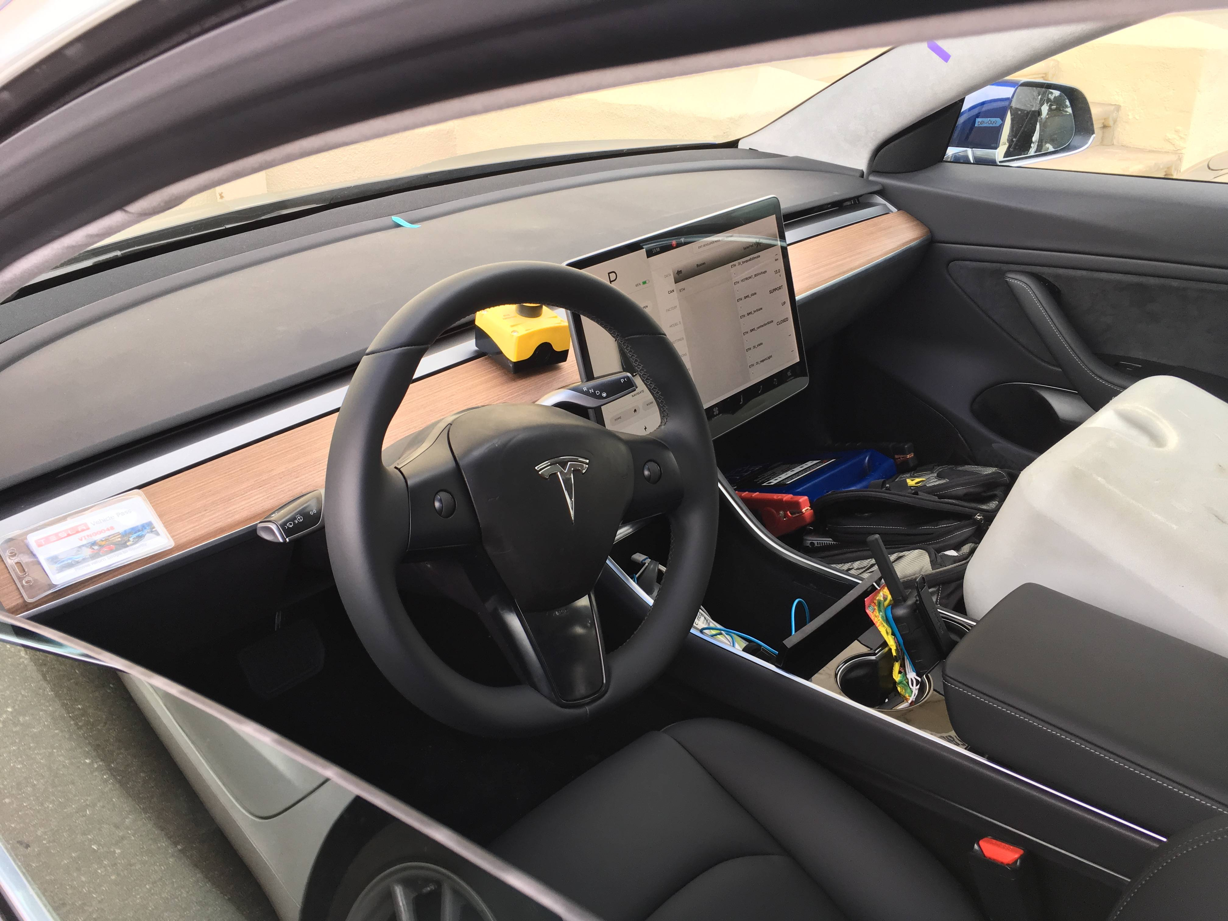 model 3 interior spied through open window shows plain. Black Bedroom Furniture Sets. Home Design Ideas