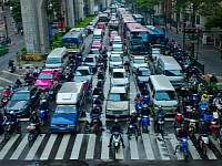 Lane splitting is illegal in many countries but it allows a more fluent traffic