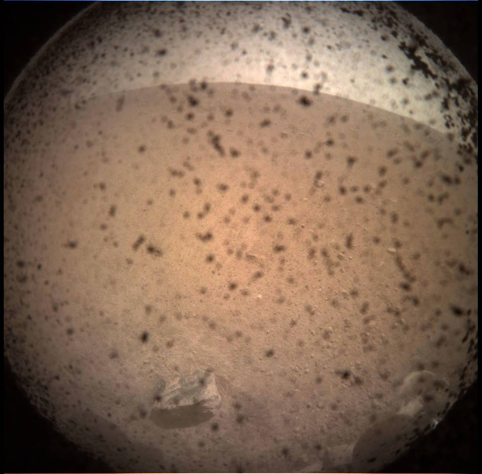 NASA InSight lander touches down on Mars, sends back first photo