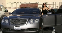 Nicole smiles to the cameras while getting into her Bentley