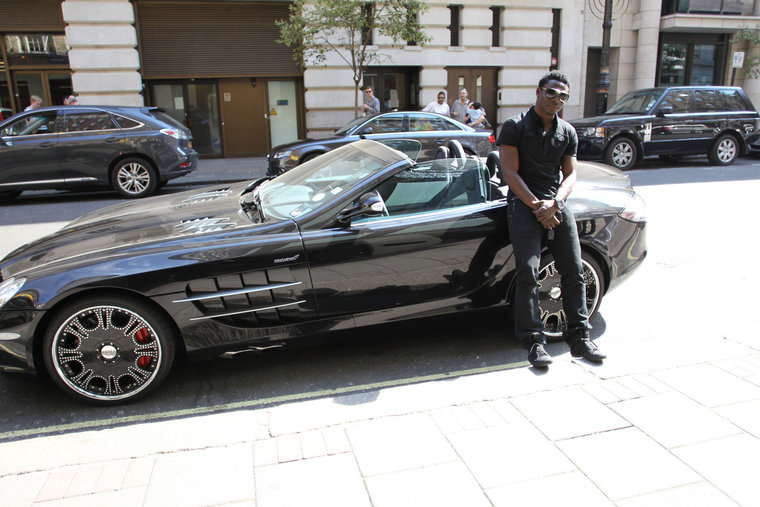 Obafemi Akinwunmi Martins Poses Next To Mclaren Slr