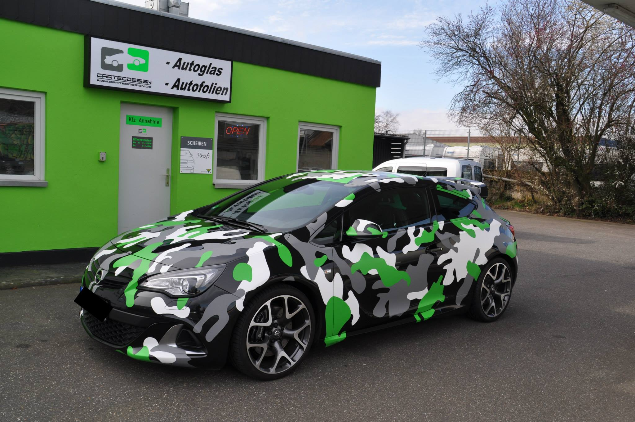 Opel Astra Opc In Camo Wrap Looks Tough Autoevolution
