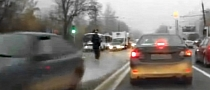 Overly-Zealous Russian Cop Uses Foot to Stop Car - Fails [Video]