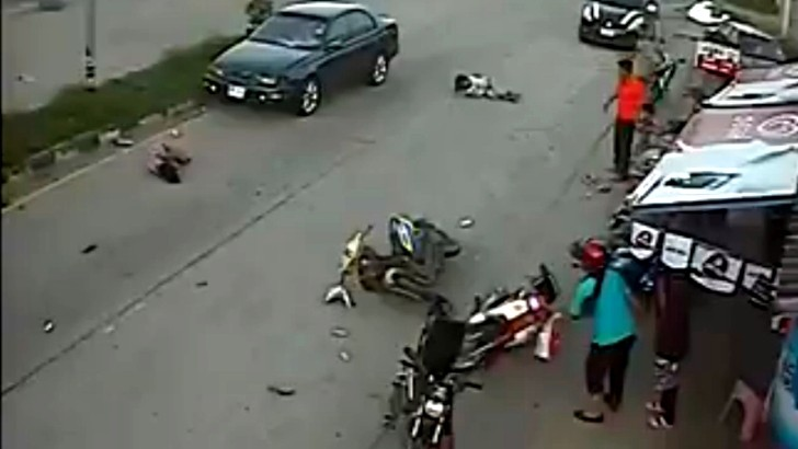 Painfully Reckless Scooter Rider Head-On Crash [Video]