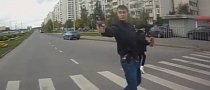Pedestrian Pulls Gun on Biker [Video]