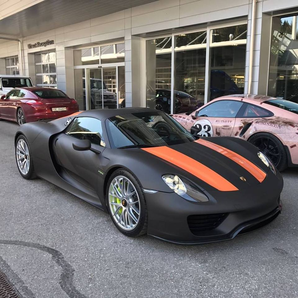 matte black porsche 918 spyder with lava orange stripes