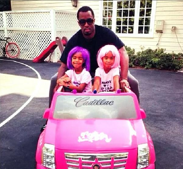 puff daddy s twin daughters drive a power wheels barbie cadillac escalade autoevolution power wheels barbie cadillac escalade