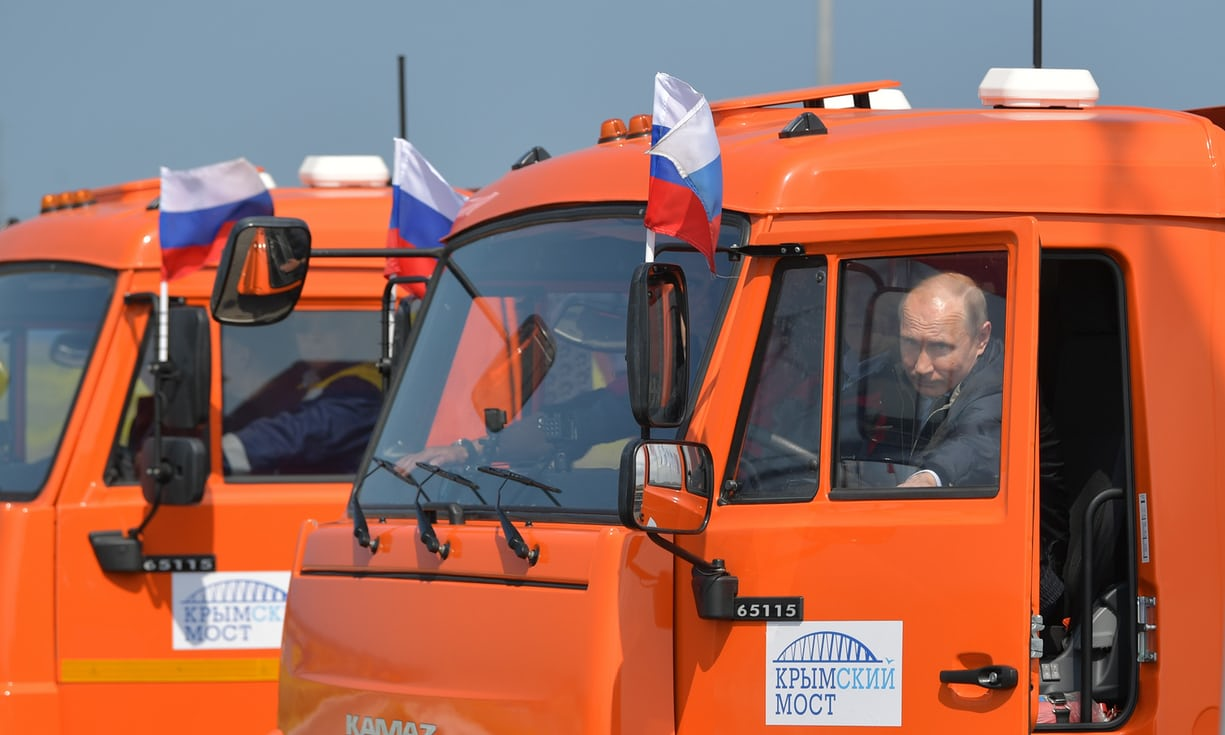 Putin Drives a Truck over New Crimea Bridge, Army of Trucks Follow