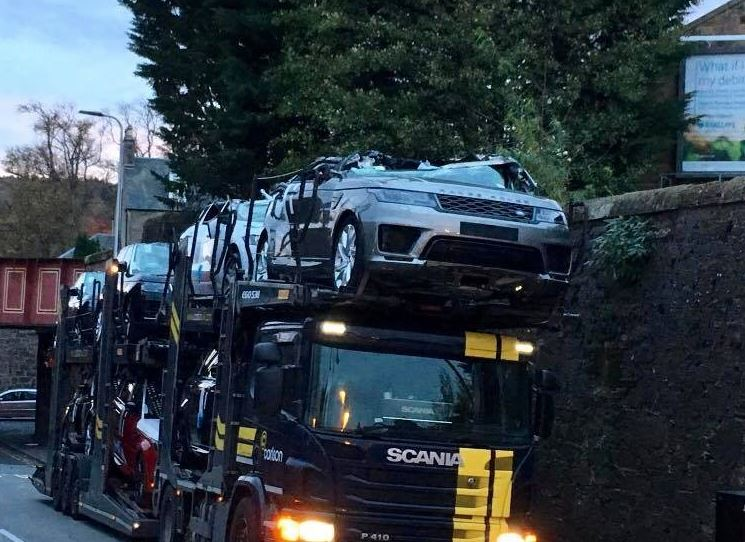 Range Rovers Crushed As Car Transporter Passes Under Low Bridge