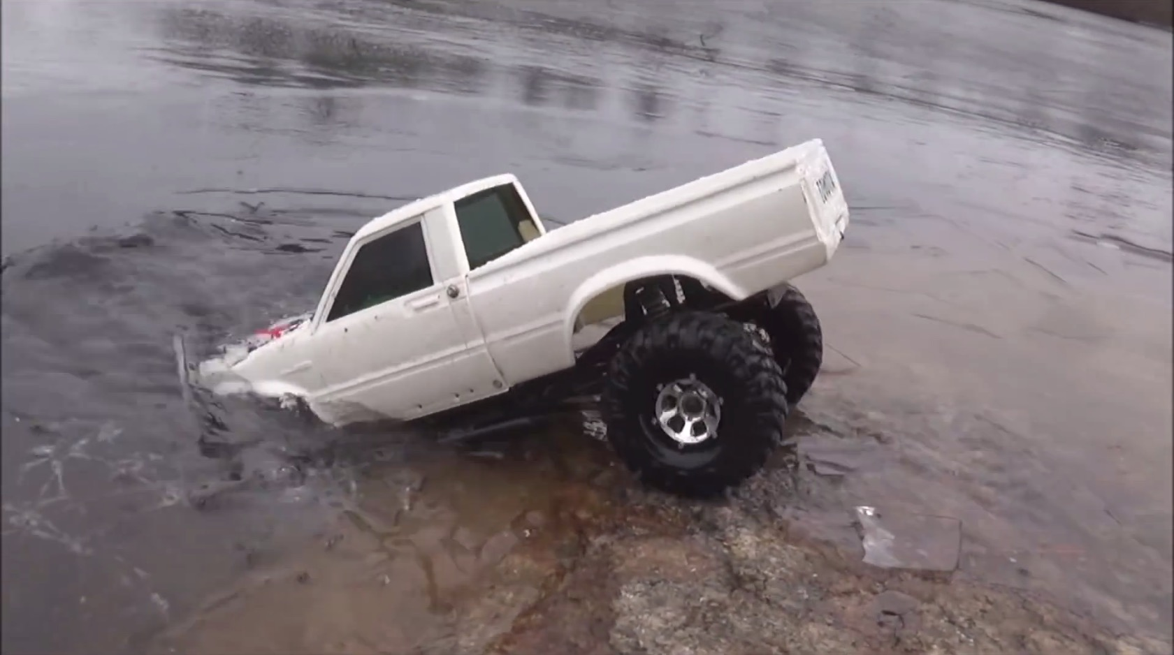 Rc Toyota Hilux Pickup Truck Drives Under The Ice Crust Of A Frozen