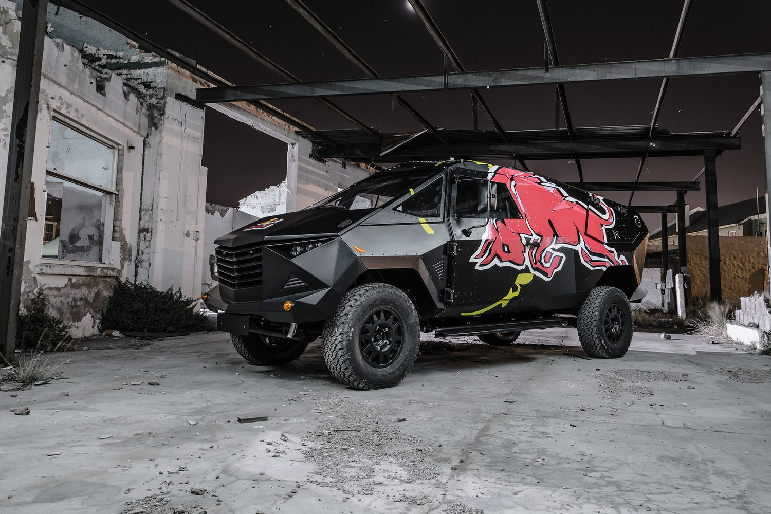 red bull reveals armored event vehicle with stealthy look land rover defender chassis. Black Bedroom Furniture Sets. Home Design Ideas
